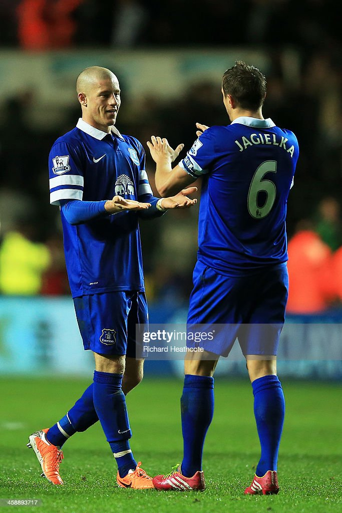 Ross Barkley of Everton celebrates with teammate Phil Jagielka following their team's 2-1 victory during the Barclays Premier League match between Swansea City and Everton at the Liberty Stadium on December 22, 2013 in Swansea, Wales.