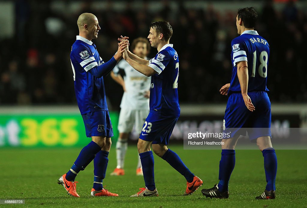 Ross Barkley of Everton celebrates with teammate Seamus Coleman following their team's 2-1 victory during the Barclays Premier League match between Swansea City and Everton at the Liberty Stadium on December 22, 2013 in Swansea, Wales.