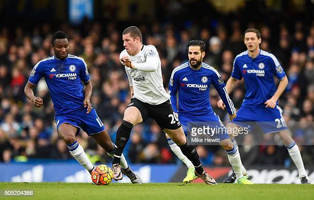 Ross Barkley of Everton controls the ball under pressure of John Mikel Obi Cesc Fabregas and Nemanja Matic of Chelsea during the Barclays Premier...