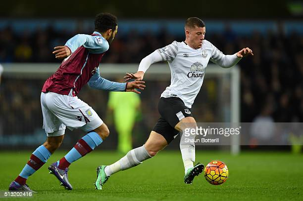 Ross Barkley of Everton controls the ball under pressure of Joleon Lescott of Aston Villa during the Barclays Premier League match between Aston...