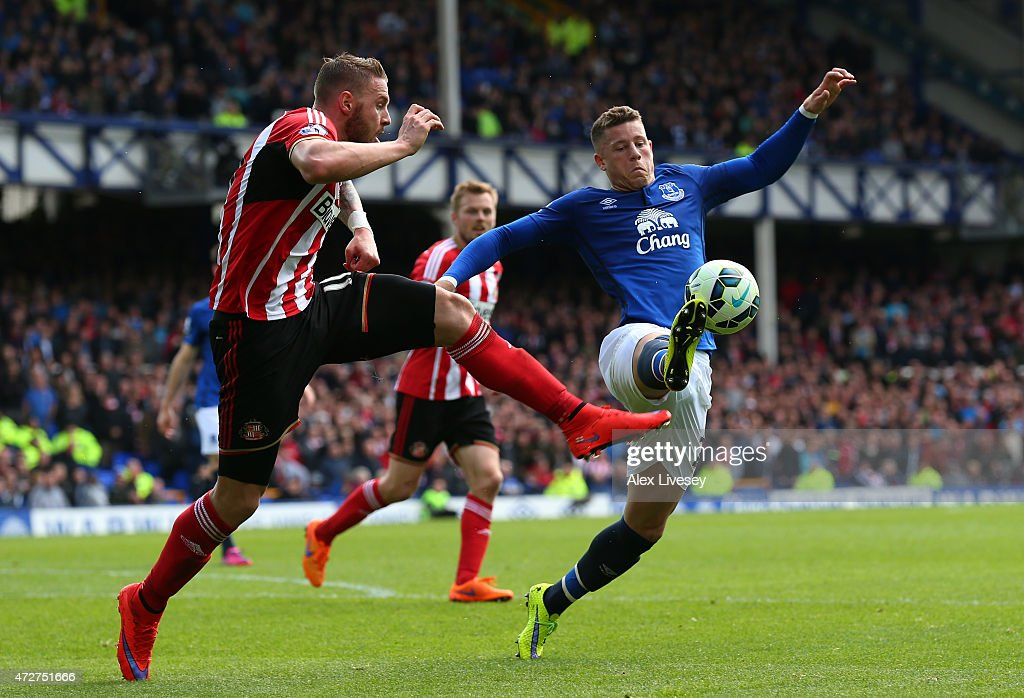 Ross Barkley of Everton is challenged by Connor Wickham of Sunderland during the Barclays Premier League match between Everton and Sunderland at Goodison Park on May 9, 2015 in Liverpool, England.