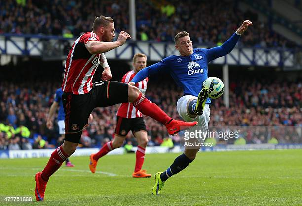 Ross Barkley of Everton is challenged by Connor Wickham of Sunderland during the Barclays Premier League match between Everton and Sunderland at...
