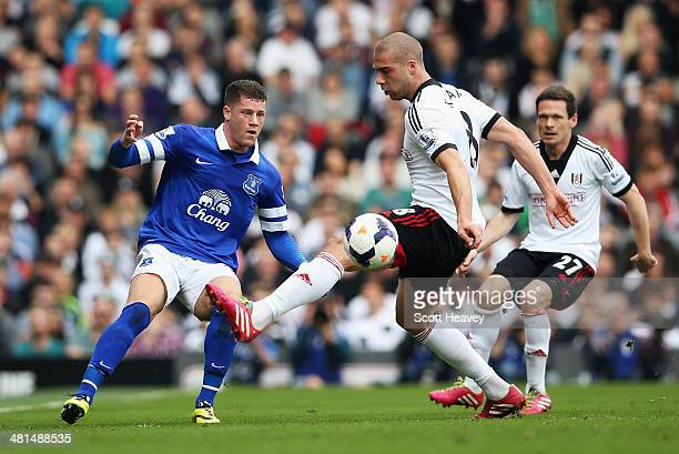 Ross Barkley of Everton is challenged by Pajtim Kasami of Fulham during the Barclays Premier League match between Fulham and Everton at Craven...