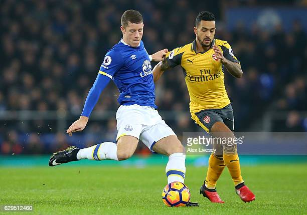 Ross Barkley of Everton is challenged by Theo Walcott of Arsenal during the Premier League match between Everton and Arsenal at Goodison Park on...