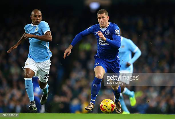 Ross Barkley of Everton is pursued by Fernandinho of Manchester City during the Capital One Cup Semi Final second leg match between Manchester City...