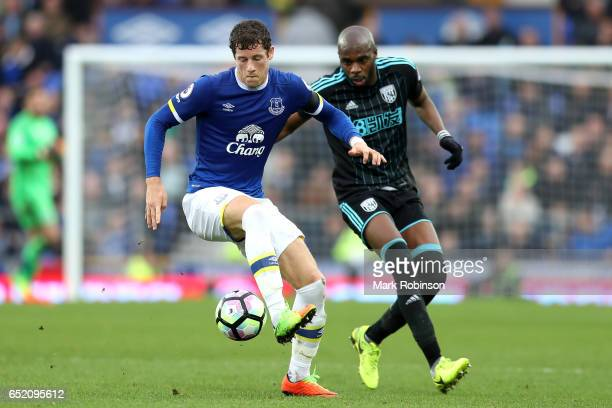 Ross Barkley of Everton is put under pressure from Allan Nyom of West Bromwich Albion during the Premier League match between Everton and West...