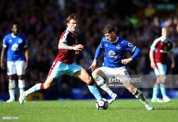 Ross Barkley of Everton is put under pressure from Jeff Hendrick of Burnley during the Premier League match between Everton and Burnley at Goodison...
