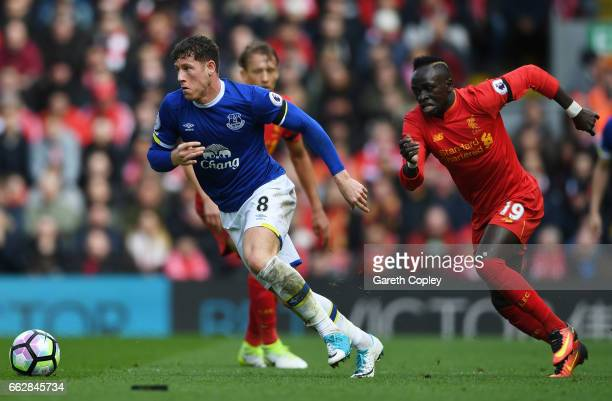 Ross Barkley of Everton is put under pressure from Sadio Mane of Liverpool during the Premier League match between Liverpool and Everton at Anfield...