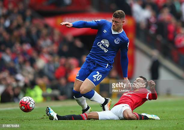 Ross Barkley of Everton is tackled by Jesse Lingard of Manchester United during the Barclays Premier League match between Manchester United and...