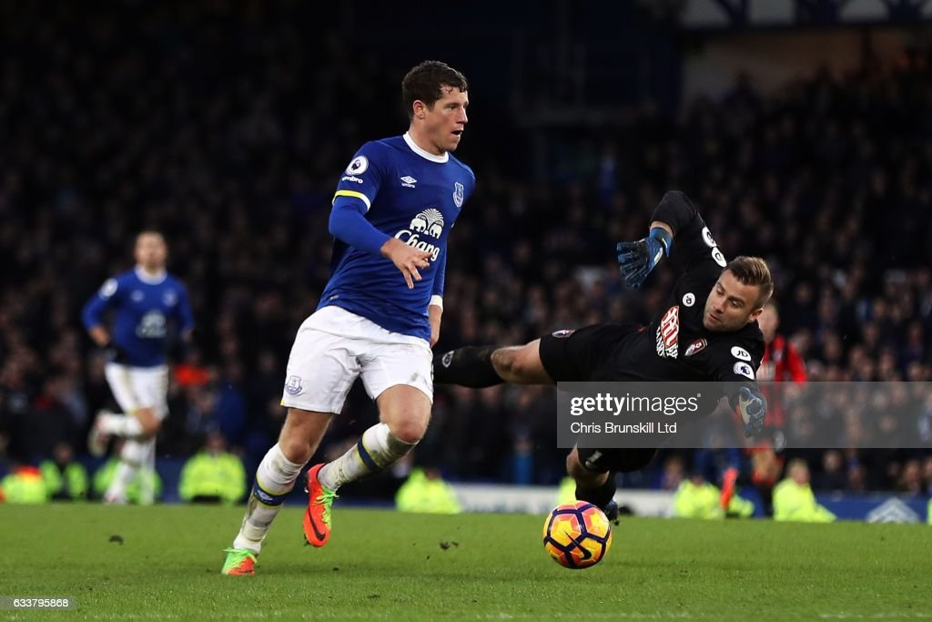 Ross Barkley of Everton rounds Artur Boruc of AFC Bournemouth before scoring his side's sixth goal during the Premier League match between Everton and AFC Bournemouth at Goodison Park on February 4, 2017 in Liverpool, England.
