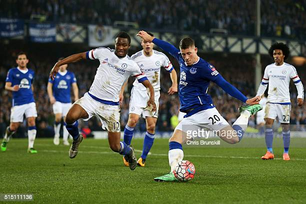 Ross Barkley of Everton shoots at goal while John Mikel Obi of Chelsea tries to block during the Emirates FA Cup sixth round match between Everton...