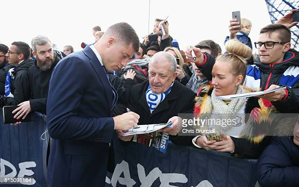 Ross Barkley of Everton signs autographs for fans on arrival at the stadium prior to the Emirates FA Cup sixth round match between Everton and...