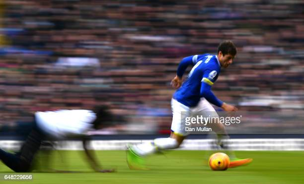 Ross Barkley of Everton takes the ball past Victor Wanyama of Tottenham Hotspur during the Premier League match between Tottenham Hotspur and Everton...