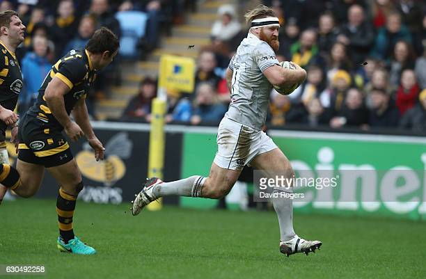 Ross Batty of Bath breaks to score a try during the Aviva Premiership match between Wasps and Bath Rugby at The Ricoh Arena on December 24 2016 in...