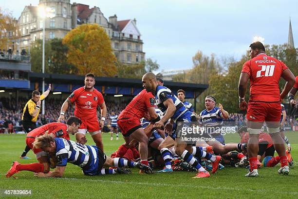 Ross Batty of Bath dives over to score his sides only try as Sebastien Bezy of Toulouse fails to stop him during the European Rugby Champions Cup...