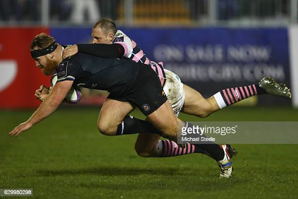 Ross Batty of Bath scores a try despite the challenge from Cory Allen of Cardiff during the European Rugby Challenge Cup match between Bath Rugby and...