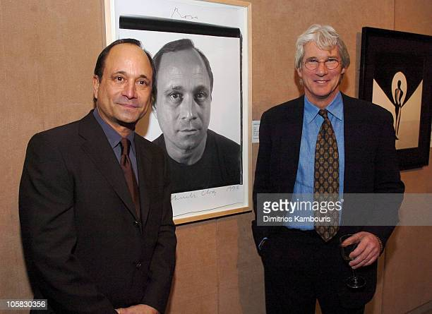 Ross Bleckner and Richard Gere during amfAR and ACRIA Honor Herb Ritts at Sotheby's in New York City New York United States