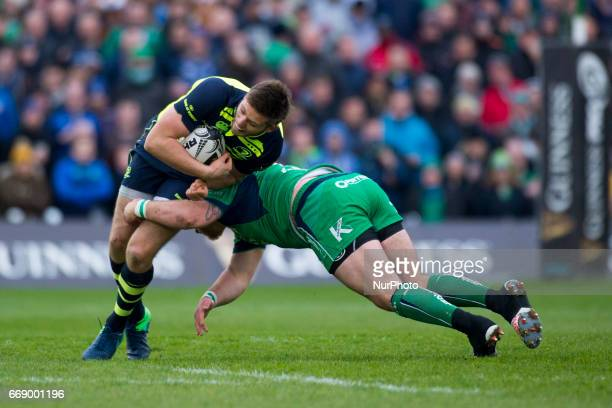 Ross Byrne of Leinster tackled by Finlay Bealham of Connacht during the Guinness PRO12 rugby match between Connacht Rugby and Leinster Rugby at the...