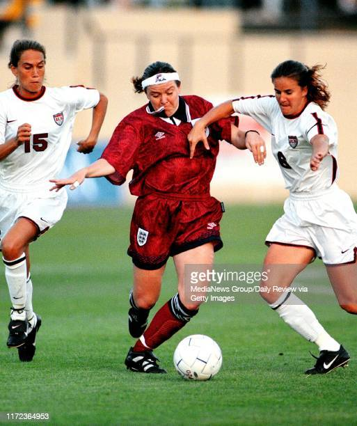 D Ross Cameron STAFF File Photo Review Sports#13#13United States' Tisha Venturini and Brandi Chastain battle England's Gillian Coultard for the ball...