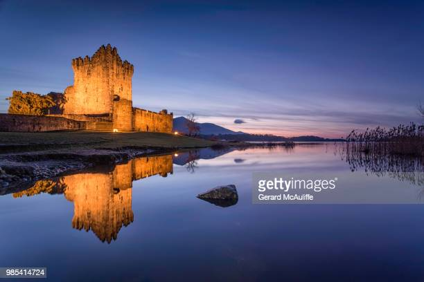 Ross Castle at sunset in Killarney, Ireland.