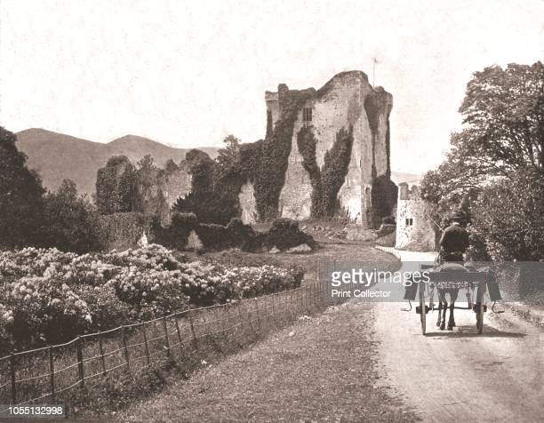 Ross Castle Isle of Ross County Kerry Ireland 1894 15thcentury tower house here seen with a donkey cart in the foreground From Beautiful Britain...