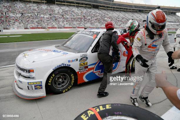 Ross Chastain climbs into the SobrietyNationorg Chevrolet as Wendell Chavous exits pit road after falling ill during the NASCAR Camping World Truck...
