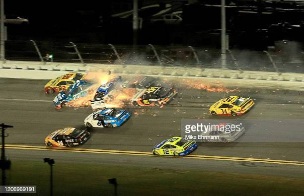 Ross Chastain driver of the AdventHealth Chevrolet crashes during the NASCAR Cup Series 62nd Annual Daytona 500 at Daytona International Speedway on...