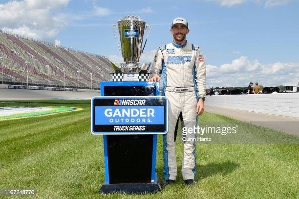 Ross Chastain driver of the Baja/Niece Equipment Chevrolet poses with the playoff trophy after the NASCAR Gander Outdoor Truck Series Corrigan Oil...