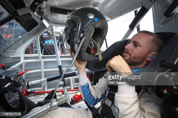 Ross Chastain driver of the Baja/Niece Equipment Chevrolet sits in his truck during practice for the NASCAR Gander Outdoor Truck Series Corrigan Oil...