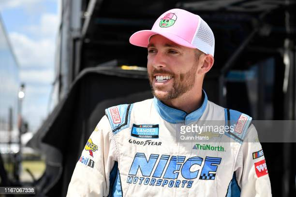 Ross Chastain driver of the Baja/Niece Equipment Chevrolet stands in the garage area during practice for the NASCAR Gander Outdoor Truck Series...