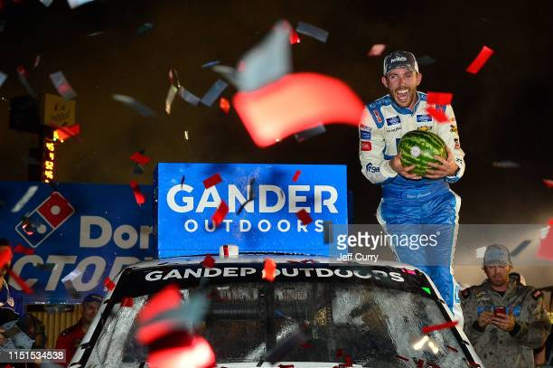 Ross Chastain driver of the CarSheildcom Chevrolet celebrates in victory lane after winning the NASCAR Gander Outdoors Truck Series CarShield 200...