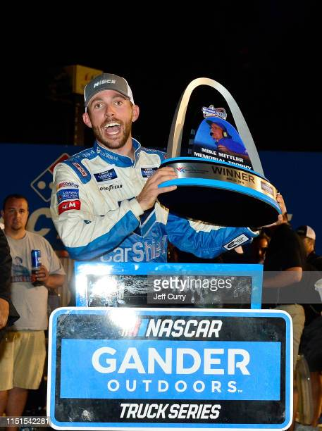 Ross Chastain driver of the CarSheildcom Chevrolet poses for photos in victory lane after winning the NASCAR Gander Outdoors Truck Series CarShield...