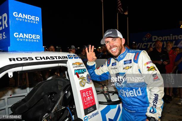 Ross Chastain driver of the CarSheildcom Chevrolet poses with the winner's sticker after winning the NASCAR Gander Outdoors Truck Series CarShield...