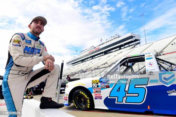 Ross Chastain driver of the CarShield Chevrolet looks on during practice for the NASCAR Gander Outdoors Truck Series NASCAR Hall of Fame 200 at...