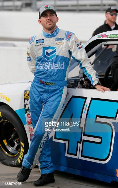 Ross Chastain driver of the CarShield Chevrolet stands by his truck during qualifying for the NASCAR Gander Outdoors Truck Series NASCAR Hall of Fame...