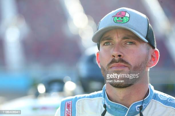 Ross Chastain driver of the CarShield Chevrolet stands by his truck during qualifying for the NASCAR Gander Outdoors Truck Series Lucas Oil 150 at...