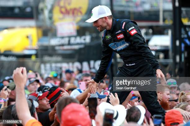 Ross Chastain driver of the Chantz Auto Group Chevrolet is introduced prior to the Monster Energy NASCAR Cup Series Bass Pro Shops NRA Night Race at...