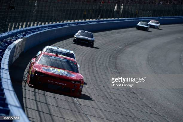 Ross Chastain driver of the Daley Technology Systems Chevrolet leads a pack of cars during the NASCAR Xfinity Series Roseanne 300 at Auto Club...