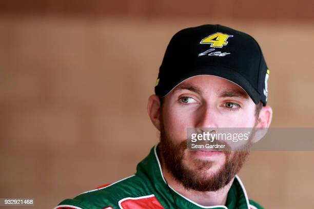 Ross Chastain driver of the Daley Technology Systems Chevrolet stands in the garage area during practice for the NASCAR Xfinity Series Roseanne 300...
