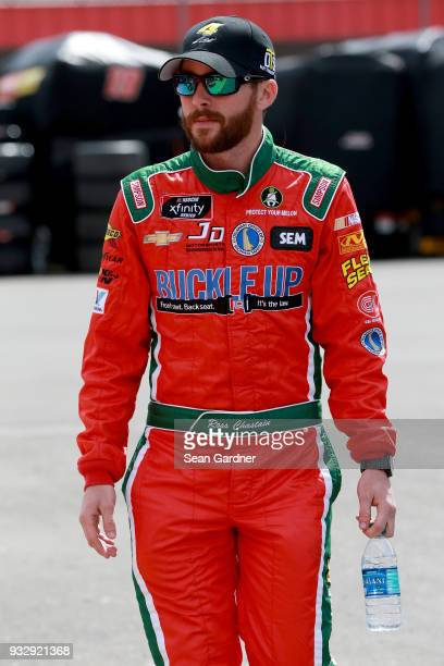 Ross Chastain driver of the Daley Technology Systems Chevrolet walks in the garage area during practice for the NASCAR Xfinity Series Roseanne 300 at...