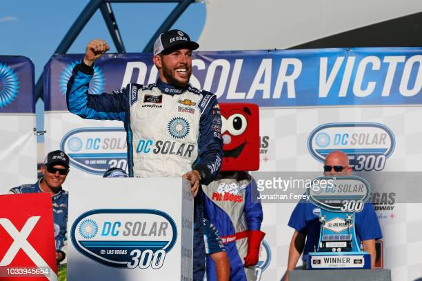 Ross Chastain driver of the DC Solar Chevrolet celebrates in Victory Lane after winning the NASCAR Xfinity Series DC Solar 300 at Las Vegas Motor...