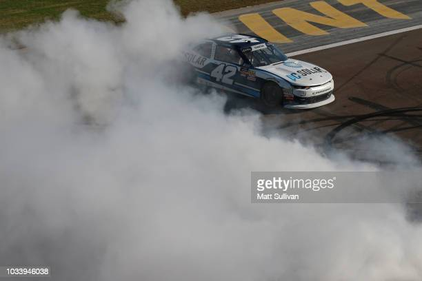 Ross Chastain driver of the DC Solar Chevrolet celebrates with a burnout after winning the NASCAR Xfinity Series DC Solar 300 at Las Vegas Motor...