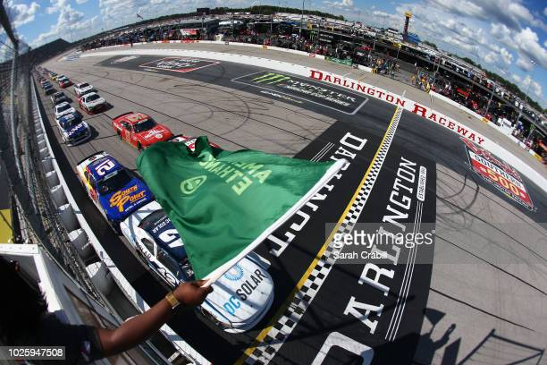 Ross Chastain driver of the DC Solar Chevrolet leads the field to green during the NASCAR Xfinity Series Sport Clips Haircuts VFW 200 at Darlington...