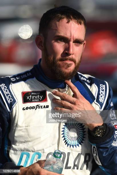 Ross Chastain driver of the DC Solar Chevrolet reacts after the conclusion of the NASCAR Xfinity Series Sport Clips Haircuts VFW 200 at Darlington...
