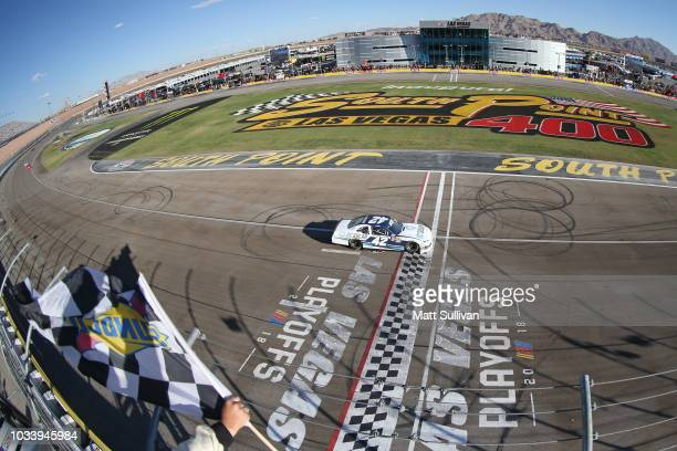 Ross Chastain driver of the DC Solar Chevrolet takes the checkered flag to win the NASCAR Xfinity Series DC Solar 300 at Las Vegas Motor Speedway on...
