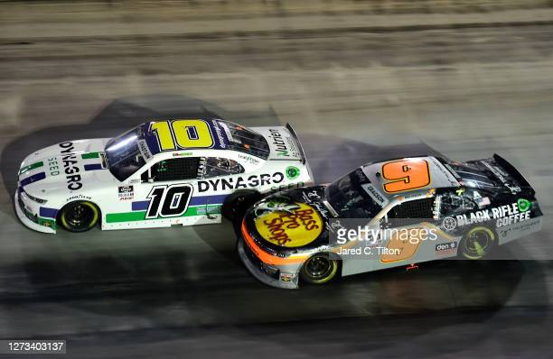 Ross Chastain, driver of the Dyna-Gro Seed Chevrolet, and Noah Gragson, driver of the Bass Pro Shops/Black Rifle Coffee Chevrolet, race during the...
