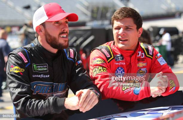 Ross Chastain driver of the Florida Watermelon Association Chevrolet talks with Vinnie Miller driver of the Flex Glue Chevrolet during practice for...