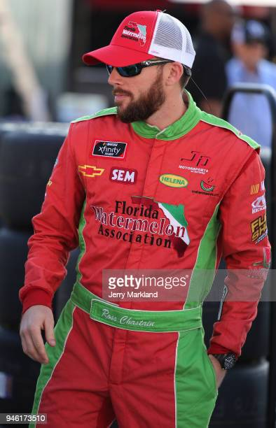 Ross Chastain driver of the Florida Watermelon Association Chevrolet walks to his car during qualifying for the NASCAR Xfinity Series Fitzgerald...