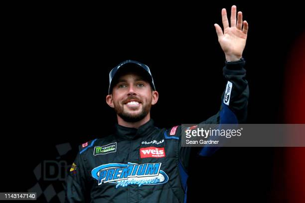 Ross Chastain driver of the Low T Center Chevrolet waves to fans during the Monster Energy NASCAR Cup Series Digital Ally 400 at Kansas Speedway on...