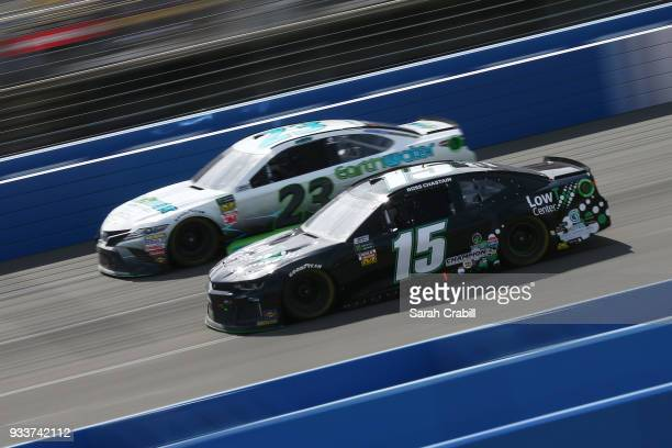 Ross Chastain driver of the LowT Center Chevrolet and Gray Gaulding driver of the Earthwater Toyota race during the Monster Energy NASCAR Cup Series...